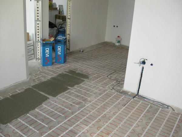 На сколько поднимется пол при укладке плитки