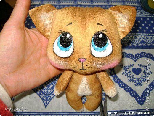 Игрушка из ткани котика