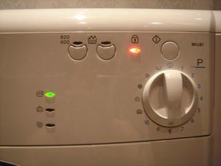 Почему на стиральной машине горит красный ключ