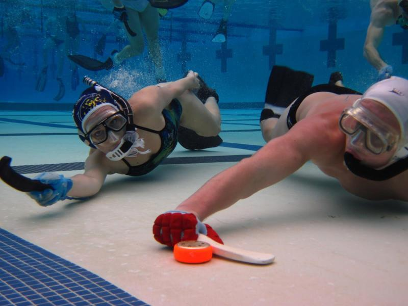 a description of underwater hockey in modern water sports Underwater hockey uwh also known as octopush mainly in the united kingdom is a globally played limitedcontact sport in which two teams before the start of play the puck is placed in the middle of the pool, and the players wait in the water whilst touching the wall above the goal they are defending.